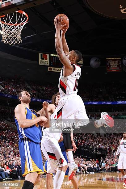 Damian Lillard of the Portland Trail Blazers shoots against the Golden State Warriors on April 13 2014 at the Moda Center Arena in Portland Oregon...