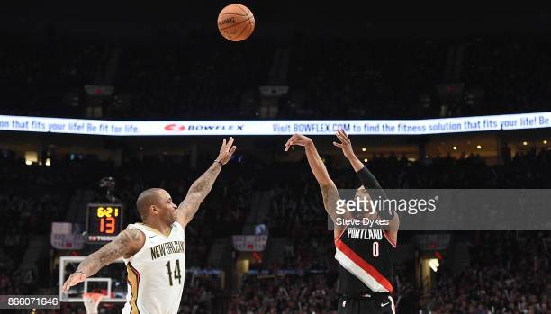 Damian Lillard of the Portland Trail Blazers shoots over Jameer Nelson of the New Orleans Pelicans during the fourth quarter of the game at Moda...