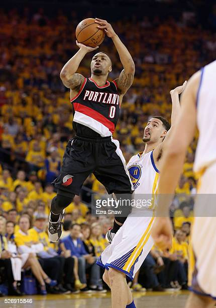 Damian Lillard of the Portland Trail Blazers shoots over Klay Thompson of the Golden State Warriors during Game One of the Western Conference...