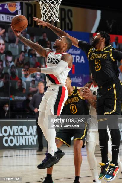Damian Lillard of the Portland Trail Blazers shoots the ball against the Los Angeles Lakers during Round One Game Four of the NBA Playoffs on August...
