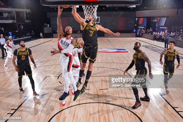 Damian Lillard of the Portland Trail Blazers shoots the ball against JaVale McGee of the Los Angeles Lakers during Round One Game Four of the NBA...