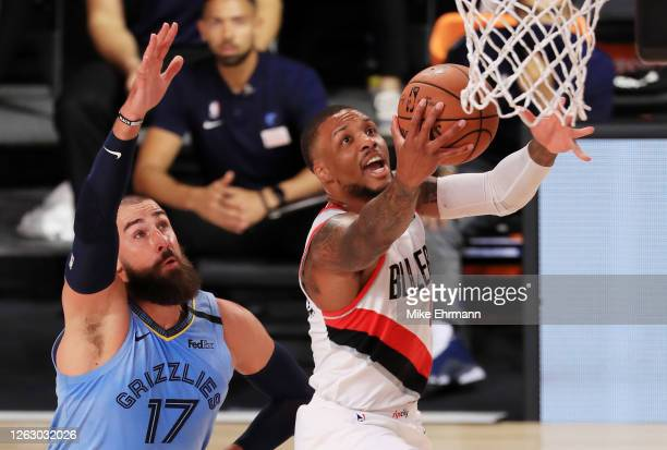 Damian Lillard of the Portland Trail Blazers shoots the ball against Jonas Valanciunas of the Memphis Grizzlies during the first half at The Arena at...