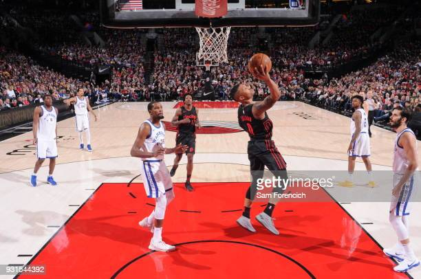 Damian Lillard of the Portland Trail Blazers shoots the ball against the Golden State Warriors on March 9 2018 at the Moda Center in Portland Oregon...