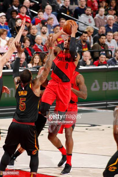 Damian Lillard of the Portland Trail Blazers shoots the ball against the Cleveland Cavaliers on March 15 2018 at the Moda Center in Portland Oregon...