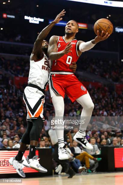Damian Lillard of the Portland Trail Blazers shoots the ball as Patrick Beverley of the Los Angeles Clippers defends during the second half at...