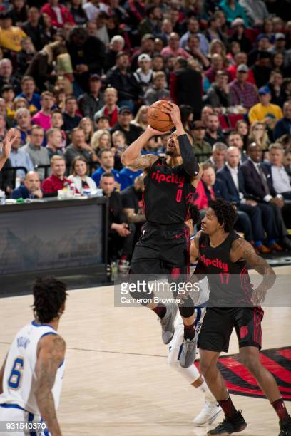 Damian Lillard of the Portland Trail Blazers shoots the ball during the game against the Golden State Warriors on March 9 2018 at the Moda Center in...