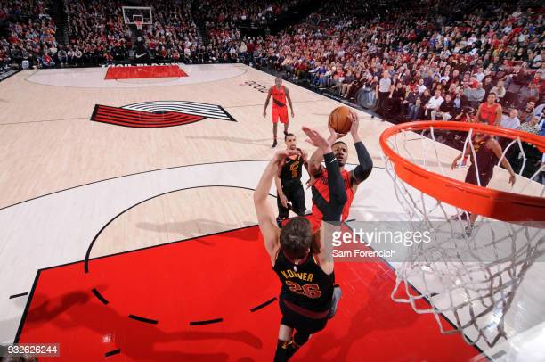 Damian Lillard of the Portland Trail Blazers shoots the ball during the game against the Cleveland Cavaliers on March 15 2018 at the Moda Center in...