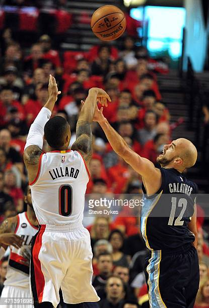 Damian Lillard of the Portland Trail Blazers shoots the ball on Nick Calathes of the Memphis Grizzlies in the first quarter of Game Four of the...