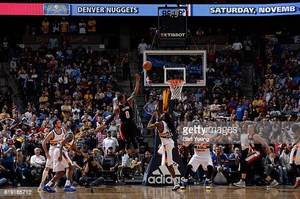 Damian Lillard of the Portland Trail Blazers shoots the game winning shot during a game against the Denver Nuggets on October 29 2016 at the Pepsi...