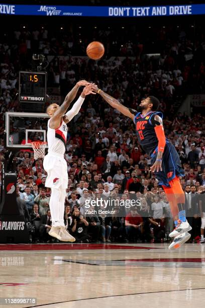 Damian Lillard of the Portland Trail Blazers shoots the three point basket over Paul George of the Oklahoma City Thunder to win the game as time...