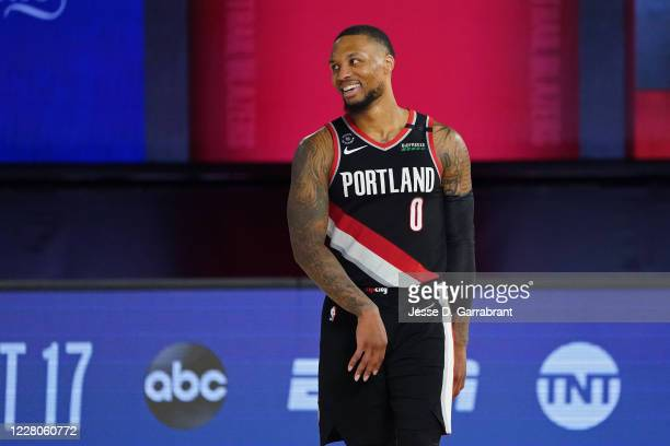 Damian Lillard of the Portland Trail Blazers smiles and celebrates after the Western Conference Play in Game against the Memphis Grizzlies on August...