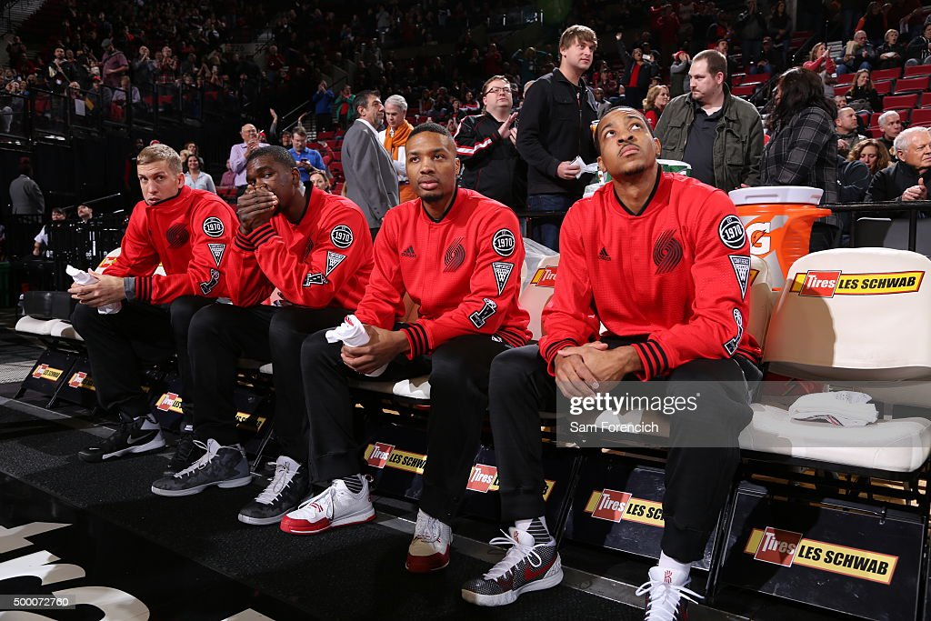 Damian Lillard #0 of the Portland Trail Blazers smiles on the bench before the game against the Dallas Mavericks on December 1, 2015 at the Moda Center Arena in Portland, Oregon.