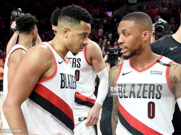 Damian Lillard of the Portland Trail Blazers speaks with CJ McCollum after the game at the Moda Center on April 14 2019 in Portland Oregon The...