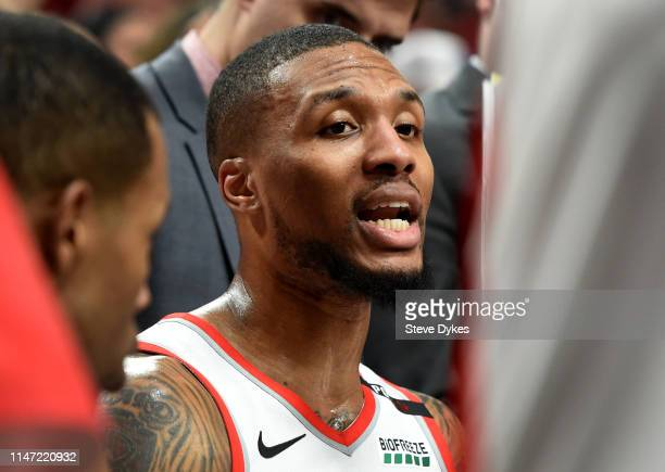 Damian Lillard of the Portland Trail Blazers speaks with his teammate during the second half of game four of the Western Conference Semifinals...