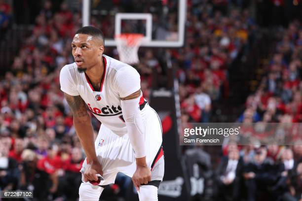 Damian Lillard of the Portland Trail Blazers stands on the cout against the Golden State Warriors in Game Three of the Western Conference...