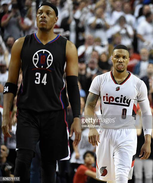 Damian Lillard of the Portland Trail Blazers stares down Paul Pierce of the Los Angeles Clippers late in the fourth quarter of Game Six of the...