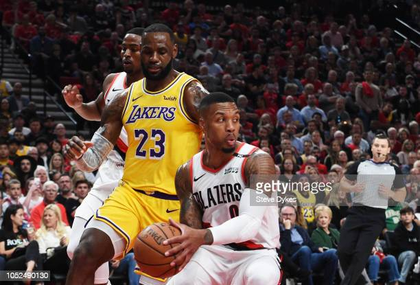 Damian Lillard of the Portland Trail Blazers steals from LeBron James of the Los Angeles Lakers in the first quarter of their game at Moda Center on...