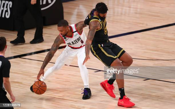 Damian Lillard of the Portland Trail Blazers steals the ball from Markieff Morris of the Los Angeles Lakers in the second half in game four of the...