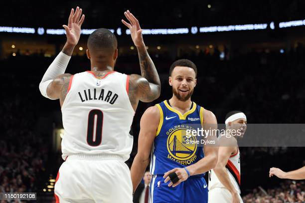 Damian Lillard of the Portland Trail Blazers Stephen Curry of the Golden State Warriors and Seth Curry of the Portland Trail Blazers react during the...