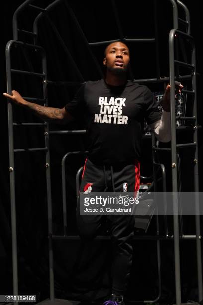Damian Lillard of the Portland Trail Blazers stretches before the game during Round One Game Four of the NBA Playoffs on August 22 2020 at...