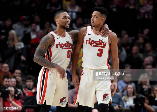 Damian Lillard of the Portland Trail Blazers tries to speak with CJ McCollum after McCollum drew a technical foul during the second half of the game...