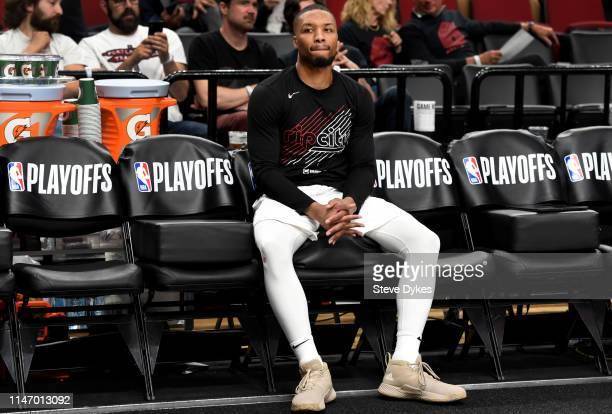 Damian Lillard of the Portland Trail Blazers waits on the bench for the start of the second half of game three of the Western Conference Semifinals...
