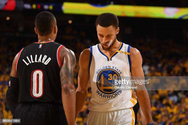 Damian Lillard of the Portland Trail Blazers walks by Stephen Curry of the Golden State Warriors during the Western Conference Quarterfinals game...