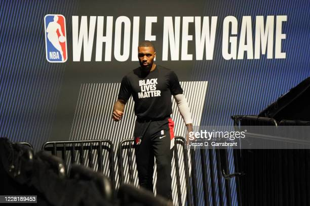Damian Lillard of the Portland Trail Blazers walks on the court before Round One Game Four of the NBA Playoffs on August 22 2020 at AdventHealth...