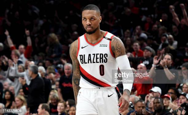 Damian Lillard of the Portland Trail Blazers walks towards the bench during a time out in the first half of Game One of the Western Conference...