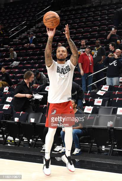Damian Lillard of the Portland Trail Blazers warms up before game three of the NBA Western Conference Finals against the Golden State Warriors at...