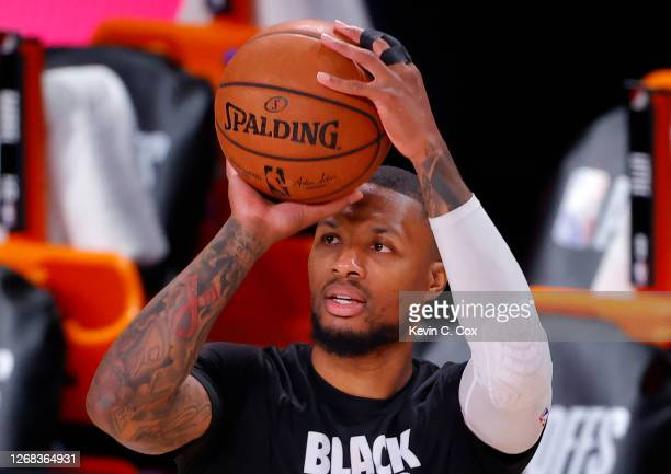Damian Lillard of the Portland Trail Blazers warms up with tape on his finger against the Los Angeles Lakers in Game Four of the Western Conference...