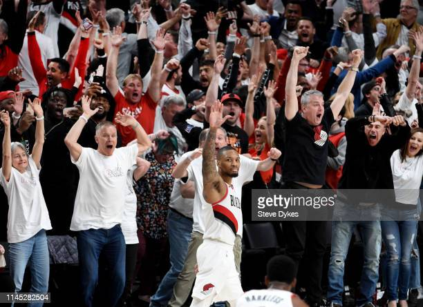 Damian Lillard of the Portland Trail Blazers waves goodbye to the Oklahoma City Thunder after hitting a last second 37 foot game winner to end Game...