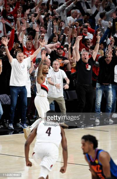 Damian Lillard of the Portland Trail Blazers waves over to the Oklahoma City Thunder bench after hitting the game winning shot in Game Five of the...