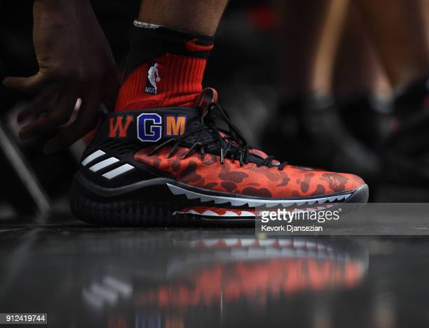 Damian Lillard of the Portland Trail Blazers wearing a Bape x Adidas Dame 4 basketball shoes during pregame warm up prior to the start of a...