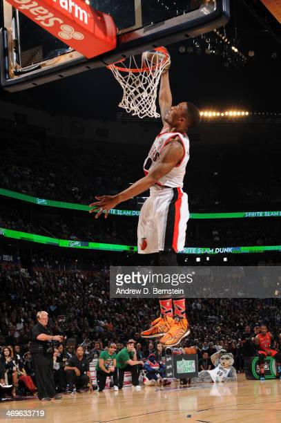 Damian Lillard of the Portland Trailblazers attempts a dunk during the Sprite Slam Dunk Contest on State Farm AllStar Saturday Night as part of the...