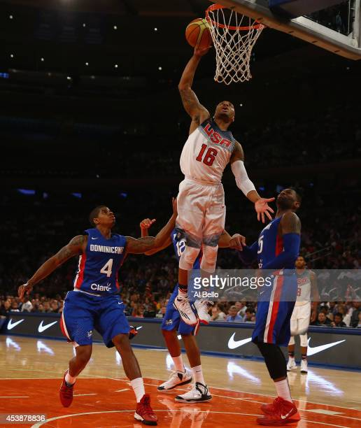 Damian Lillard of the USA shoots against Elpidio Fortuna and Juan Coronado of the Dominican Republic during their game at Madison Square Garden on...