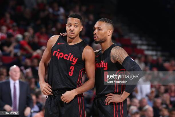 Damian Lillard speaks to CJ McCollum of the Portland Trail Blazers during the game against the Charlotte Hornets on February 8 2018 at the Moda...