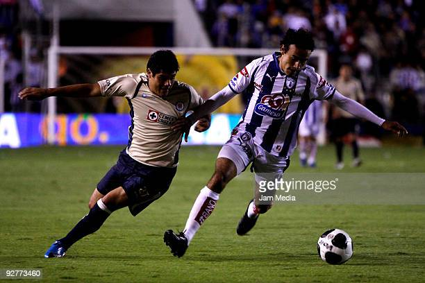 Damian Manso of Pachuca vies for the ball with Javier Orozco of Cruz Azul during their Mexican league Apertura 2009 soccer match at the Hidalgo...