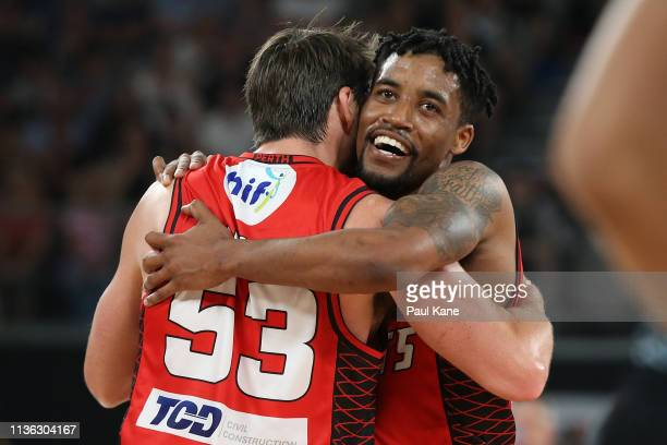 Damian Martin and Bryce Cotton of the Wildcats celebrate after winning the NBL championship during game 4 of the NBL Grand Final Series between...