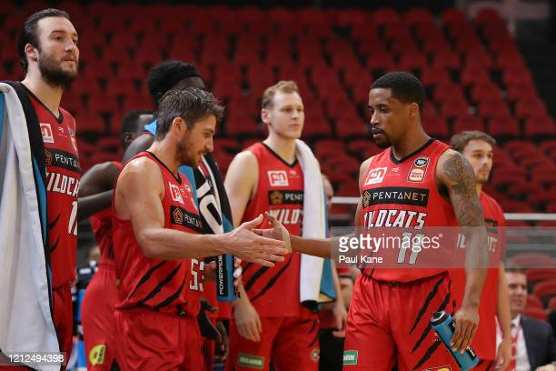 Damian Martin and Bryce Cotton of the Wildcats celebrate in the final seconds during game three of the NBL Grand Final series between the Sydney...