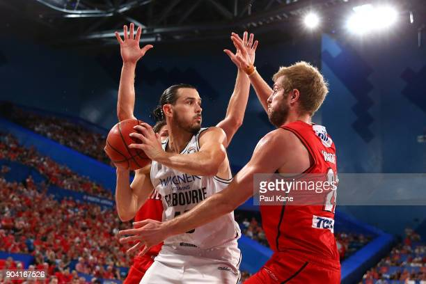 Damian Martin and Jesse Wagstaff of the Wildcats apply pressure to Chris Goulding of United during the round 14 NBL match between the Perth Wildcats...