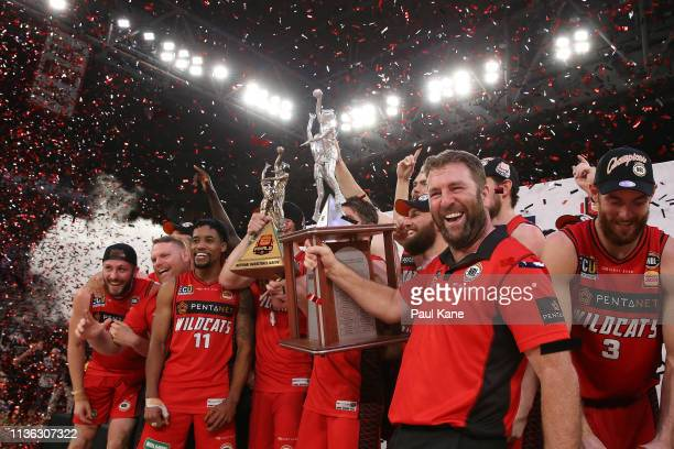 Damian Martin and Trevor Gleeson of the Wildcats hold the trophy aloft after winning the NBL championship during game 4 of the NBL Grand Final Series...