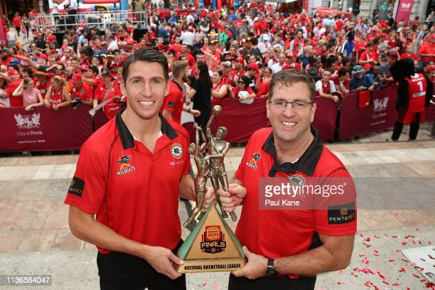 Damian Martin and Trevor Gleeson pose with the 2018/19 NBL Championship trophy and fans after winning their ninth NBL championship at Forrest Place...