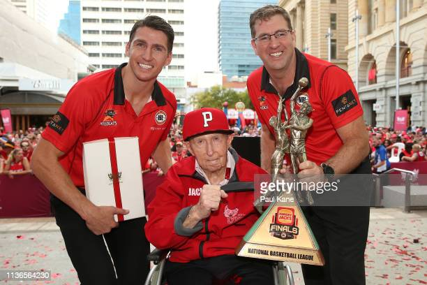Damian Martin, Jack Bendat and Trevor Gleeson pose with the 2018/19 NBL Championship trophy and fans after winning their ninth NBL championship at...