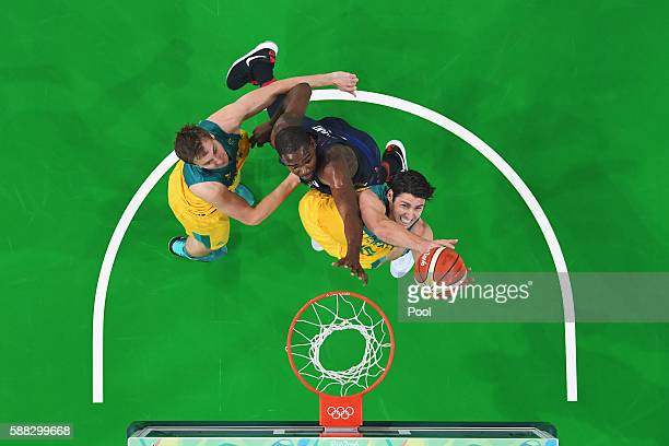 Damian Martin of Australia goes to the basket against Kevin Durant of United States during the Men's Preliminary Round Group A between Australia and...