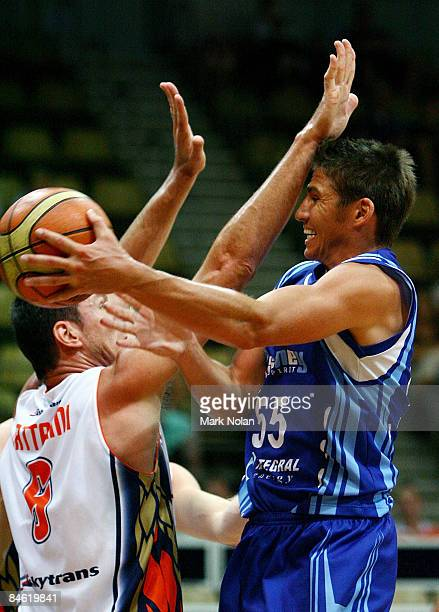 Damian Martin of the Spirit passes the ball during the round 21 NBL match between the Sydney Spirit and the Cairns Taipans held at Sydney Olympic...