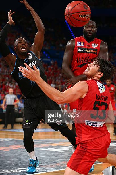 Damian Martin of the Wildcats and Cedric Jackson of the Breakers contest for a loose ball during game one of the NBL Grand FInal series between the...