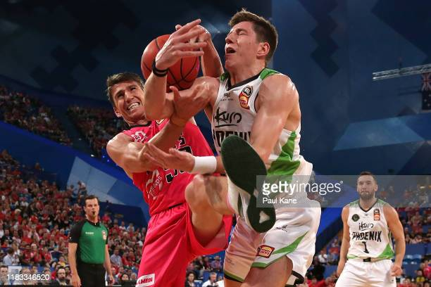 Damian Martin of the Wildcats and Dane Pineau of the Phoenix contest for the ball during the round four NBL match between the Perth Wildcats and the...