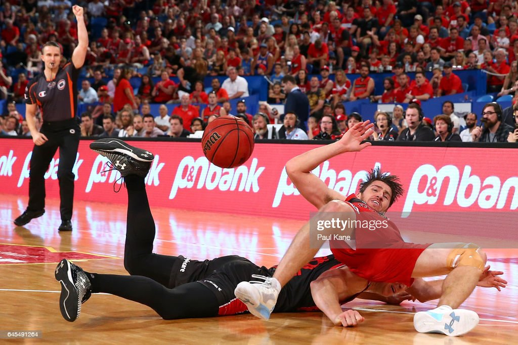 Damian Martin of the Wildcats and Tim Coenraad of the Hawks contest for the ball during game one of the NBL Grand Final series between the Perth Wildcats and the Illawarra Hawks at Perth Arena on February 26, 2017 in Perth, Australia.