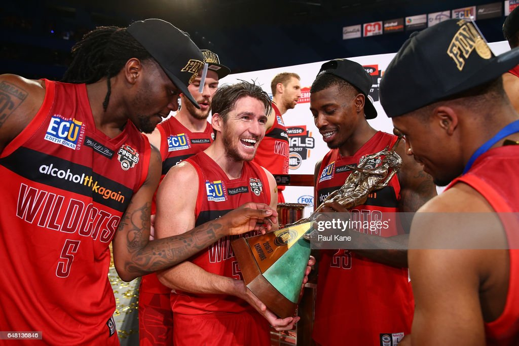 Damian Martin of the Wildcats celebrates with the trophy with Jameel McKay, Angus Brandt, Casey Prather and Bryce Cotton after winning game three and the NBL Grand Final series between the Perth Wildcats and the Illawarra Hawks at Perth Arena on March 5, 2017 in Perth, Australia.